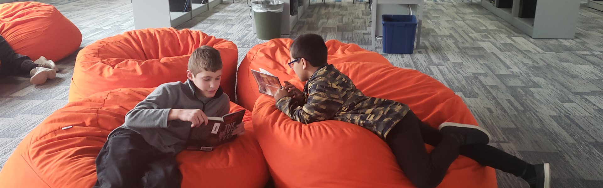 Reading and relaxing on the bean bags.